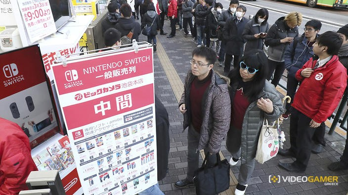 Customers form a long line to buy Nintendo Co.'s new Switch game console at an electronics wholesaler shop in Toshima Ward, Tokyo on March 3, 2017. Nintendo has kicked off the game console overe 3,000 stores across Japan with a price 29,980 Japanese yen. ( The Yomiuri Shimbun via AP Images )